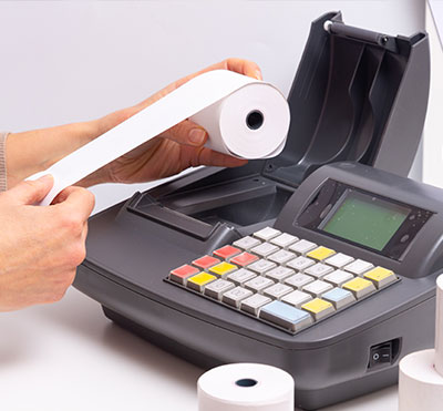 till roll receipt being placed in till