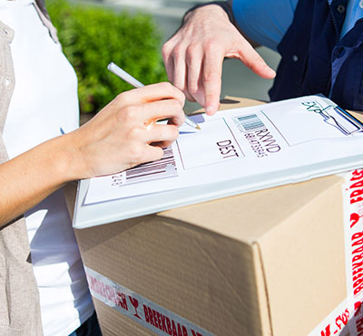 woman signing for delivery of goods